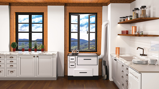 Beli šporet na drva u prostranoj beloj kuhinji, smešten pored prozora sa predivnim pogledom na brda i prirodu
